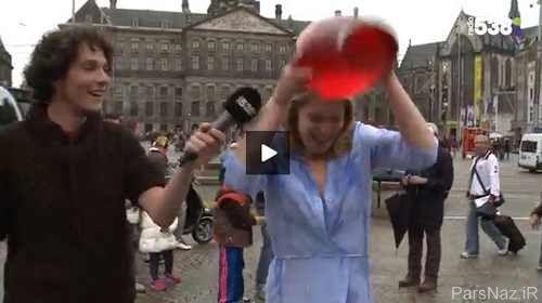لخت شدن دختر در خیابان و انجام چالش آب یخ + عکس 1