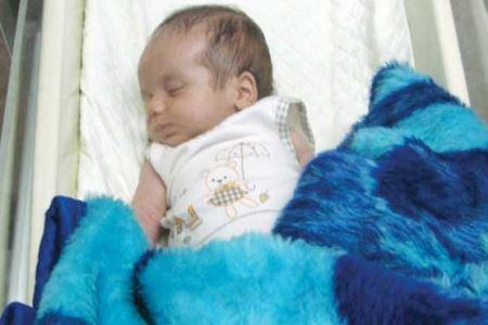 عکس طفل 20 روزه شکنجه شده در تهران