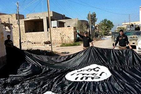 بزرگترین پرچم داعش سرنگون شد +عکس