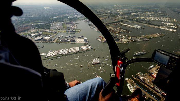 عبور کشتی های بزرگ و کوچک در روز آمستردام