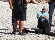 برخورد پلیس با خانم محجبه در کنار ساحل
