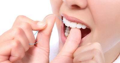 آموزش استفاده اصولی از نخ دندان