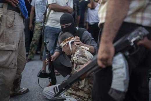 عکس سر بریدن یک سرباز سوری (18+)